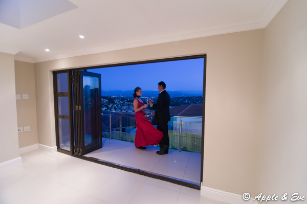 The couple enjoying the early evening view from the balcony adjoining the study.