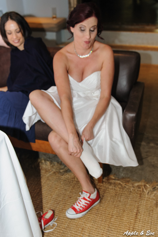 A quick change of shoes for the bride.
