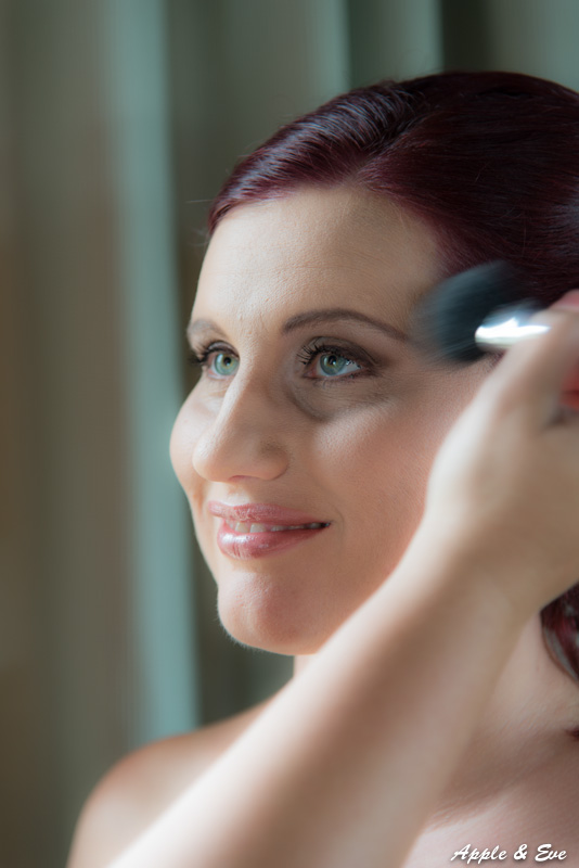Our bride getting ready. Makeup expertly applied by Juanita, a close friend of Ronel.