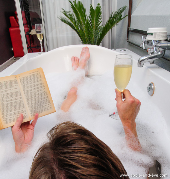 Take a lazy outside bath, have some bubbly, and read a book!