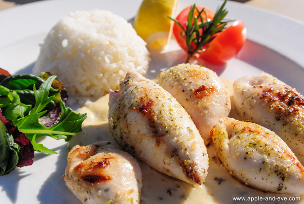 Enoy some fine seafood such as stuffed calamari tubes, pan-fried to perfection  and drizzled with a creamy garlic sauce.