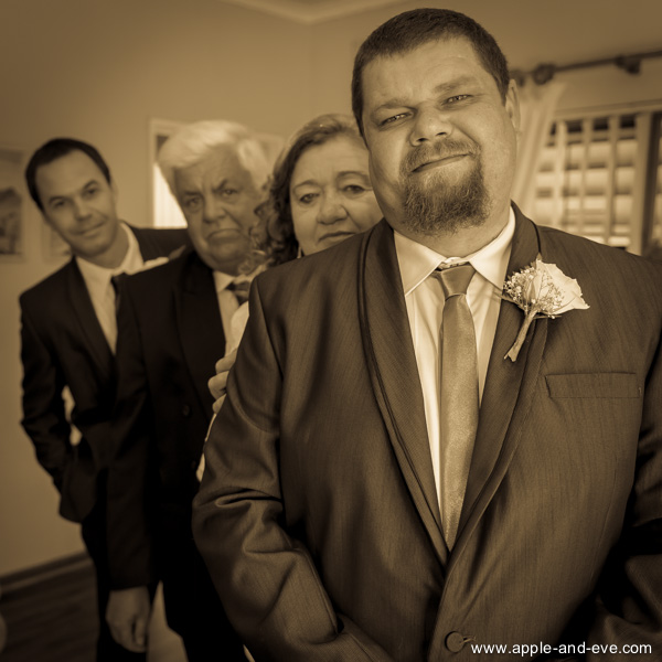 The groom with parents and best-man.