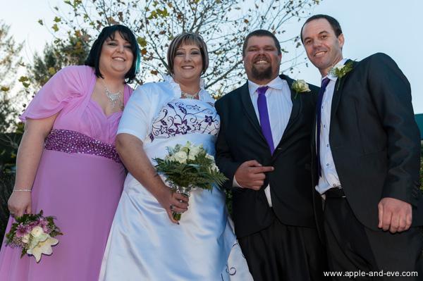 Bride's maid, bride, groom, and best man.