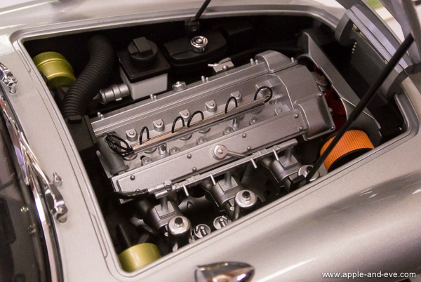 The engine bay of a model Aston Martin DB5 - similar to the well-known James Bond car. See the incredible detail on a model only the size of a case of beer.