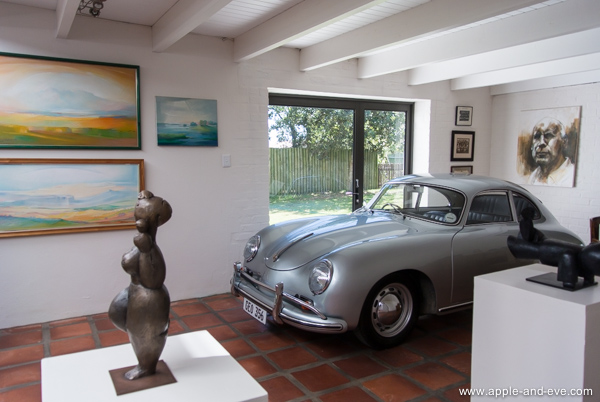 Situated high on a mountain close to the ocean is Iona, makers of excellent Sauvignon Blanc, Pinot Noir, and other equally excellent wine. What drew our attention immediately was this lovely Porsche parked inside an office next to the tasting room!, surrounded by beautiful artwork.