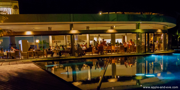 Night view of one of the resort restaurants as seen from the pool.