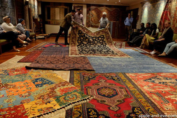 Carpet upon carpet is being rolled out to gawking visitors while the intricate and beautiful handwork is explained, as well as the origin of each carpet, and the meaning of symbols on the carpet. Come with money!